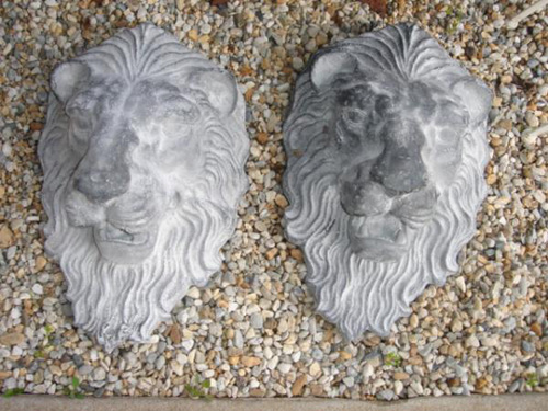 Pair Lion mask Heads lead finish